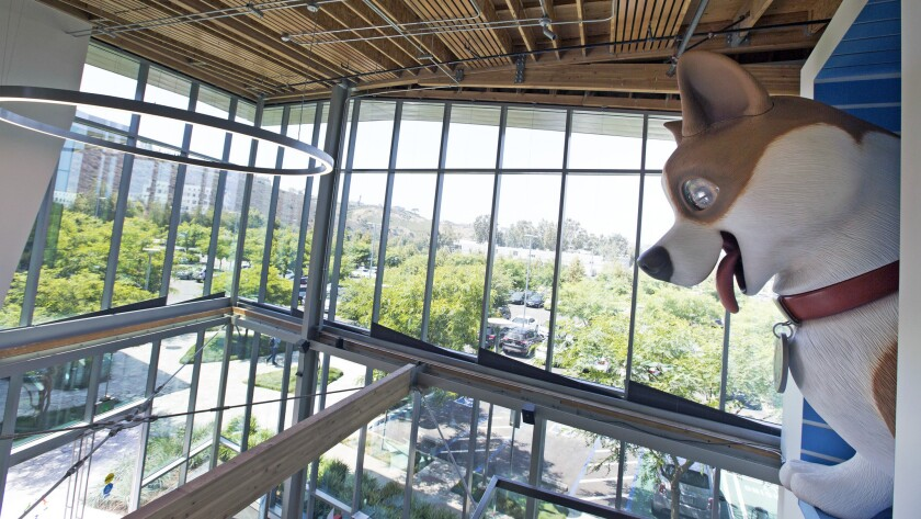 A giant animatronic dog overlooks the entry at new PetSpace L.A.