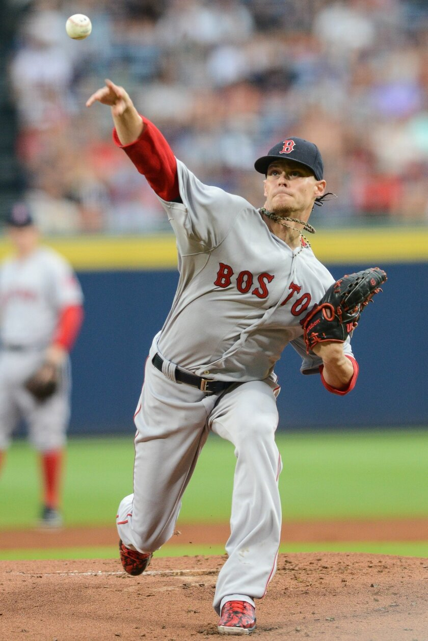 Boston Red Sox starting pitcher Clay Buchholz (11) works in the first inning of a baseball game against the Atlanta Braves Thursday, June 18, 2015, in Atlanta. (AP Photo/Jon Barash)