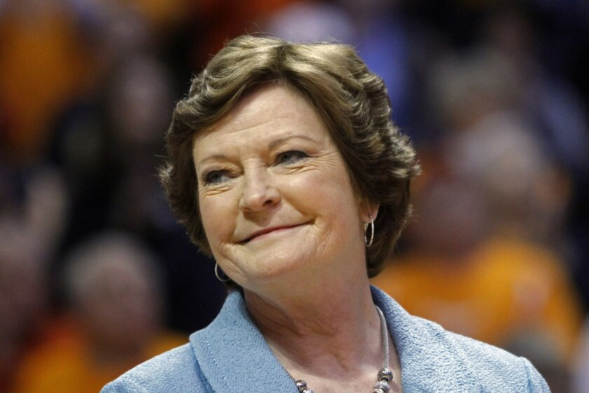 """FILE - In this Jan. 28, 2013 file photo, Tennessee head coach emeritus Pat Summitt smiles as a banner is raised in her honor before an NCAA college basketball game against Notre Dame, in Knoxville, Tenn. Summitt will remain the Tennessee women's basketball head coach emeritus next season and can continue holding the position as long as she wants it. That's according to a new contract signed in May and obtained Thursday night, July 3, 2014, through a public records request. It states that Summitt will have the title head coach emeritus """"in perpetuity, or until she chooses to relinquish it."""" (AP Photo/Wade Payne, File)"""