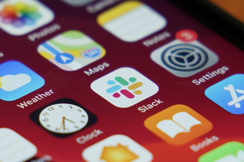 A close-up of Slack app icon on an iPhone screen.