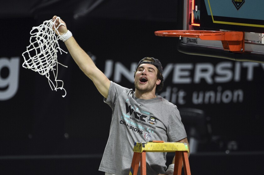 Gonzaga forward Corey Kispert holds up the net after Gonzaga defeated BYU in an NCAA college basketball game for the West Coast Conference men's tournament championship Tuesday, March 9, 2021, in Las Vegas. (AP Photo/David Becker)
