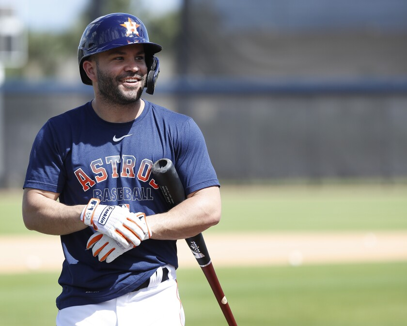 Houston Astros second baseman Jose Altuve (27) smiles before taking batting practice during spring training baseball practice, Tuesday, Feb. 18, 2020 in West Palm Beach, Fla.