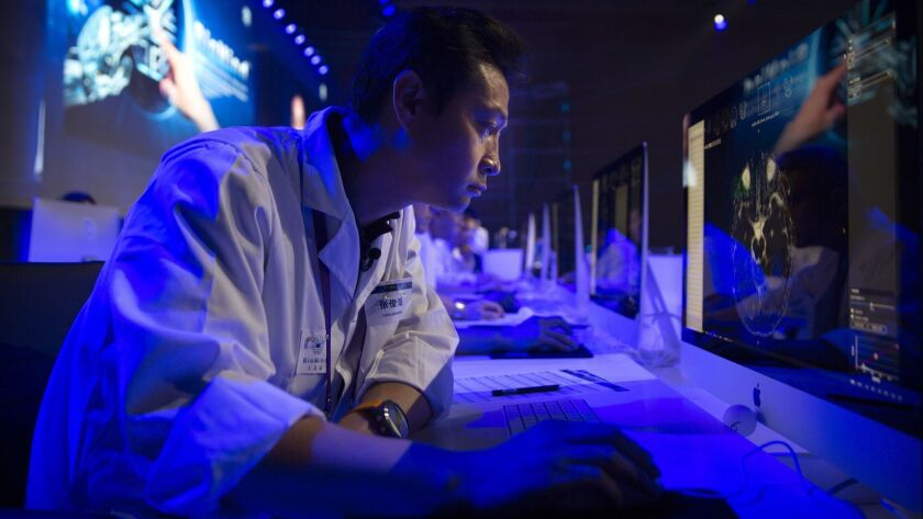 A doctor examines an image during the CHAIN Cup, the world's first competition in neuroimaging between AI and human experts, in Beijing on June 30, 2018.