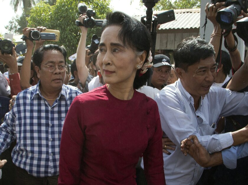 Leader of Myanmar's National League for Democracy party, Aung San Suu Kyi visits a polling station on the outskirts Yangon, Myanmar, Sunday, Nov. 8, 2015. Myanmar voted Sunday in historic elections that will test whether popular mandate will help loosen the military's longstanding hold on power eve