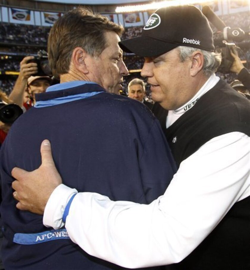 San Diego Chargers coach Norv Turner, left, and New York Jets coach Rex Ryan greet each other after the Jets beat the Chargers 17-14 in an NFL divisional playoff football game Sunday, Jan. 17, 2010, in San Diego. (AP Photo/Denis Poroy)