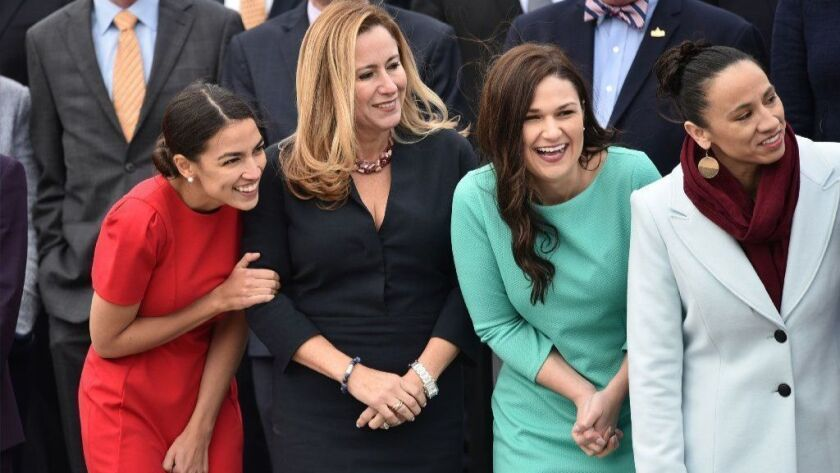 Reps. Alexandria Ocasio-Cortez (D-N.Y.), Debbie Mucarsel-Powell (D-Fla.), Abby Finkenauer (D-Iowa) and Sharice Davids (D-Kan.) pose for the 116th Congress members-elect group photo on the East Front Plaza of the U.S. Capitol in November 2018.
