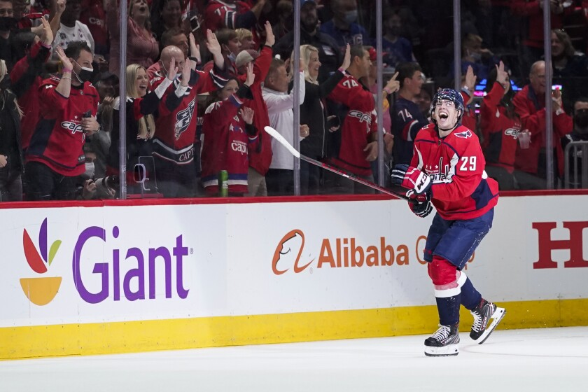 Washington Capitals center Hendrix Lapierre celebrates his goal during the second period of the team's NHL hockey game against the New York Rangers, Wednesday, Oct. 13, 2021, in Washington. (AP Photo/Alex Brandon)