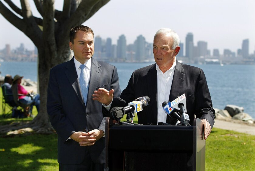 San Diego Mayor Jerry Sanders (right) endorses mayoral candidate Carl DeMaio (left) on Tuesday at Harbor Island Park in San Diego, California.