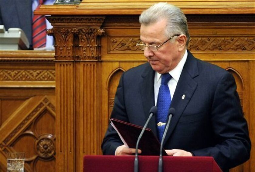Hungarian President Pal Schmitt pauses after he announced his resignation during the plenary session of the Parliament in Budapest, Hungary, Monday, April 2, 2012. Last week the Senate of Semmelweis University revoked the doctor title from Hungarian President Pal Schmitt over plagiarism charges. (AP Photo/MTI, Laszlo Beliczay)