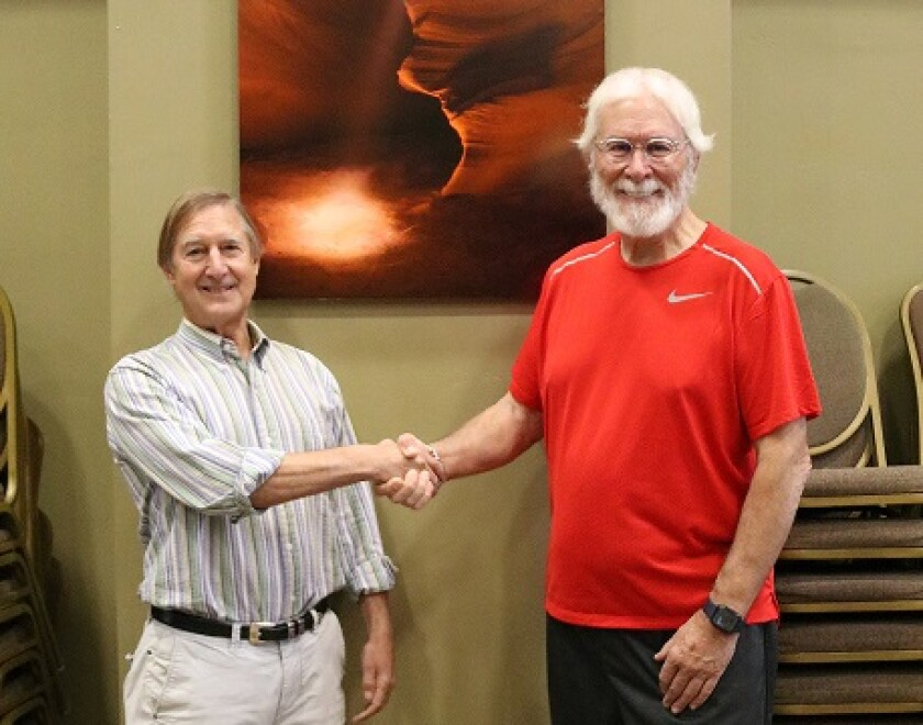 Dr. Stuart Grauer (left), founder of The Grauer School, with photographer John Rowe.
