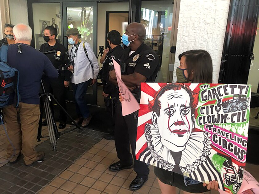 Protesters disrupted the celebration of a new office space for a city dept that will investigate human rights complaints.