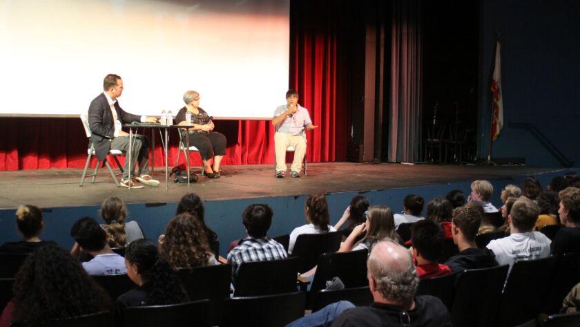 La Jolla Playhouse dramaturg Shirley Fishman and playwright Mike Lew speak to a room of La Jolla High School students.