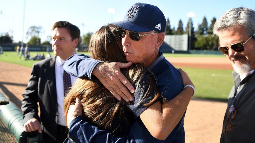 LOS ANGELES, CALIFORNIA MAY 17, 2018-U.C. Irvine baseball coach Mike Gillespie hugs a family member