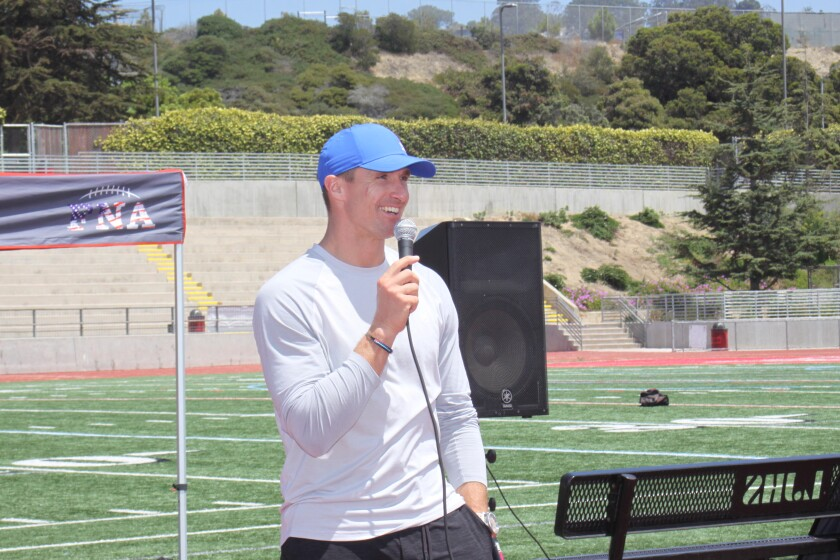 New Orleans Saints quarterback and FNA co-founder Drew Brees speaks at La Jolla High School's athletic field.