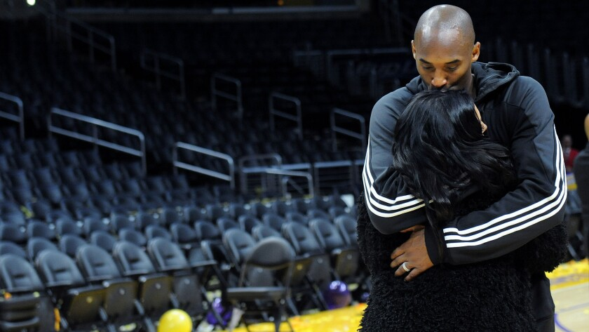 Kobe Bryant kisses his wife, Vanessa, after his last game at Staples Center on April 13, 2016.