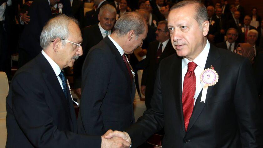 Turkey's President Recep Tayyip Erdogan, right, shakes hands with Kemal Kilicdaroglu left, head of t