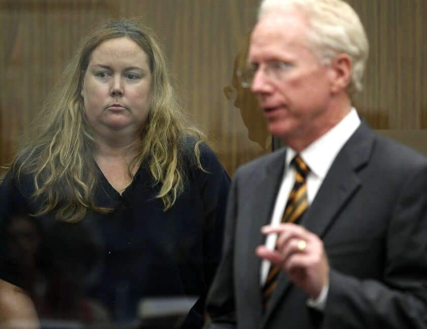 Julie Elizabeth Harper with her attorney, Paul Pfingst, at a court hearing in 2013.