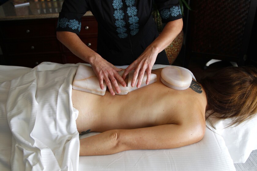 Chopra Center massage therapist Danyel Potts does a treatment on Laurie Delk at The Chopra Center.