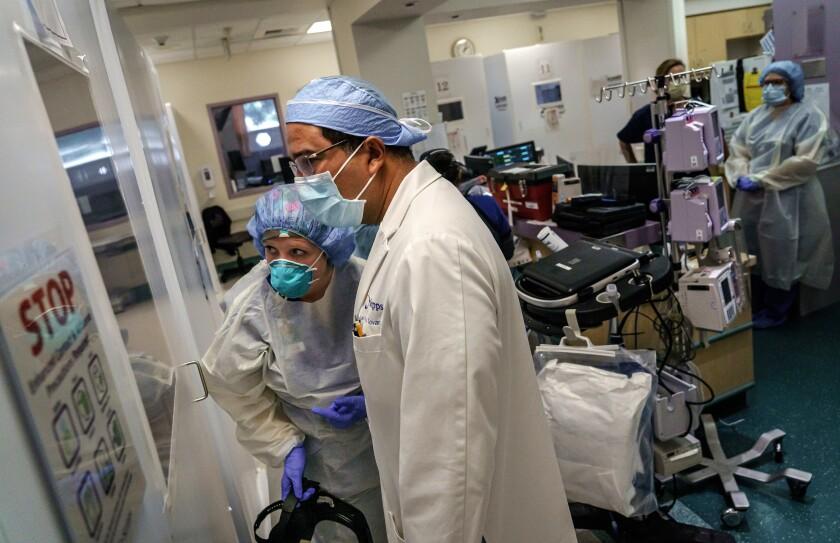 Dr. Juan Tovar and nurse practitioner Charlotte Thomas observe an intubation at Scripps Mercy Hospital Chula Vista.
