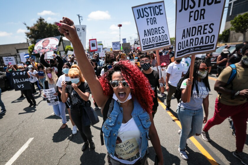 Protesters at a rally  or Andres Guardado, a Gardena man who was fatally shot by a Los Angeles County sheriff's deputy.