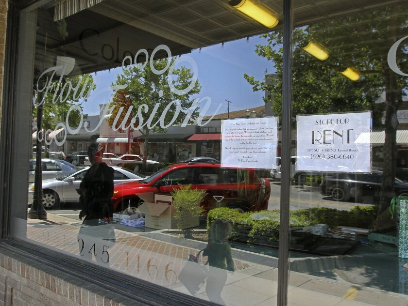 Signs in the window notify people walking by that Flour Fusion, a bakery/restaurant on Main Street in Lake Elsinore, has closed.