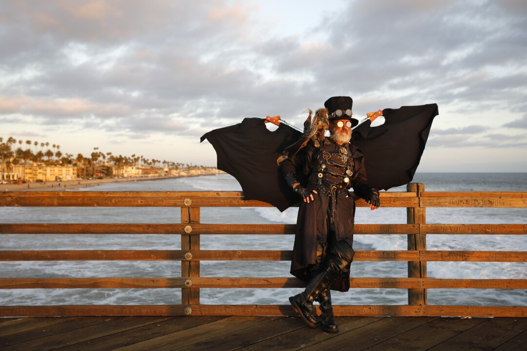 Dean LeCrone dressed as Dr. Artemus Peepers, a steampunk hero, at the Oceanside Pier.