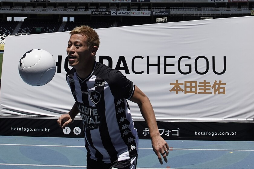 Japan's Keisuke Honda controls the ball during his official presentation as the newest member of the Botafogo soccer club, at Nilton Santos stadium in Rio de Janeiro, Brazil, Saturday, Feb. 8, 2020. Honda, considered one of Japan's most successful players who played in the last three World Cups, has signed on to play for Botafogo. (AP Photo/Leo Correa)