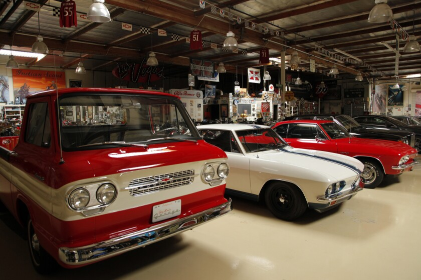 Various classic vehicles are part of the collection.