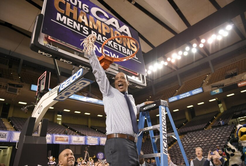 UNC Wilmington head coach Kevin Keatts reacts after he finished cutting down the net after an NCAA college basketball game in the Colonial Athletic Association Championship against Hofstra, Monday, March 7, 2016, in Baltimore. UNC Wilmington won 80-73 in overtime. (AP Photo/Nick Wass)