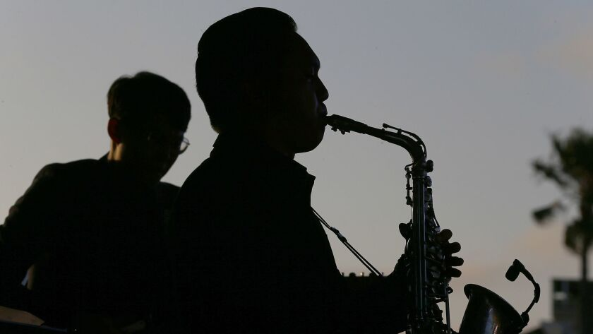 Jazz musicians perform with David Benoit outside the Lighthouse