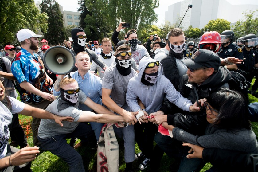 Members of the so-called Rise Above Movement face off with counter-protesters during a rally in Berkeley on April 15, 2017.