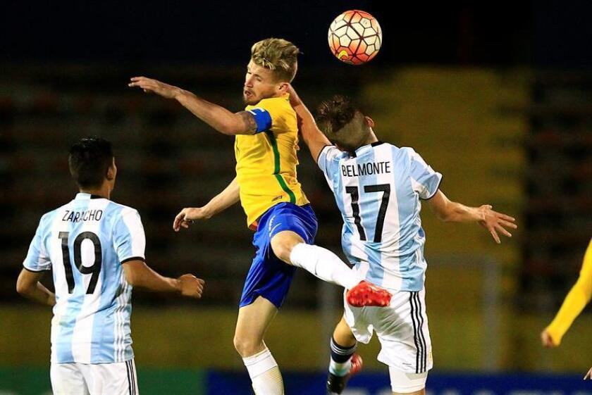 Brazilian midfielder Caio Henrique (C) battles Argentines Tomas Belmonte (R) and Matias Zaracho (L) for the ball during the South American Under-20 match played on Feb. 8, 2017, at Atahualpa Stadium in Quito, Ecuador. EPA-EFE FILE/Jose Jacome
