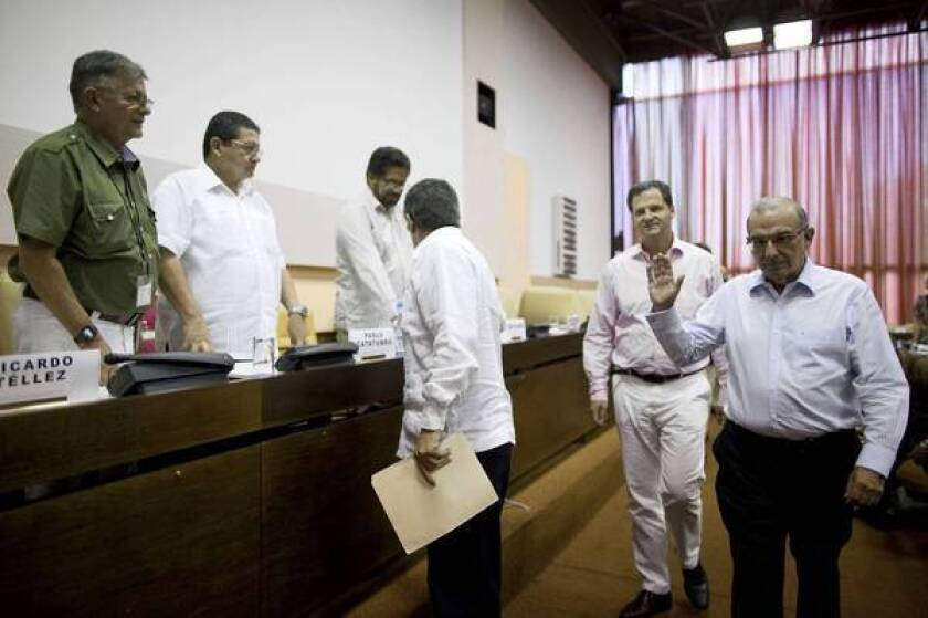 Colombia, FARC rebels reach deal on land reform