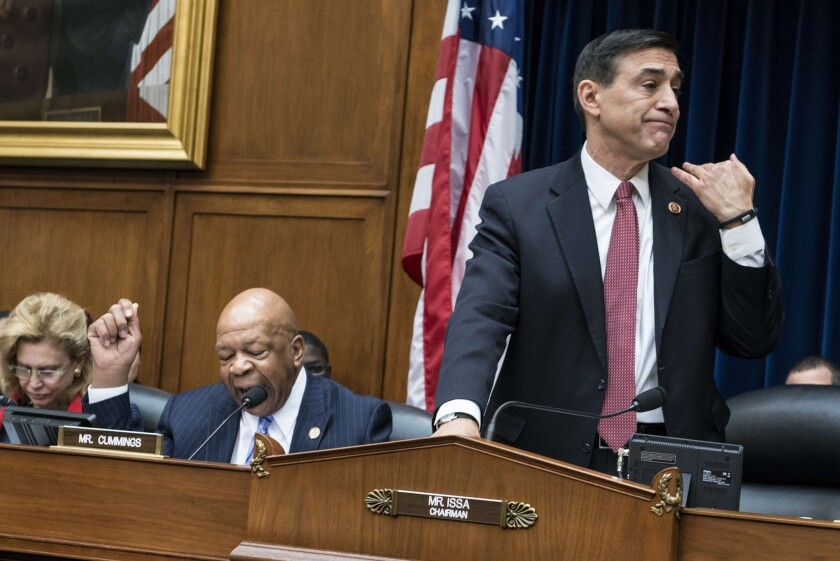 On the right, Chairman Rep. Darrell Issa, R-Vista, cuts off ranking member Rep. Elijah Cummings, D-Maryland, on the left, during a hearing of the House Oversight and Government Reform Committee on March 5, 2014 in Washington, DC.