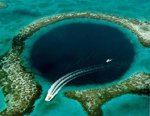 """There are many blue holes off the coast of Belize, but the """"great"""" Blue Hole on Lighthouse Reef Atoll is the one most visible in a flyover -- and the most famous one for diving. The hole is about 1,000 feet in diameter and 412 feet deep. -- Los Angeles Times"""