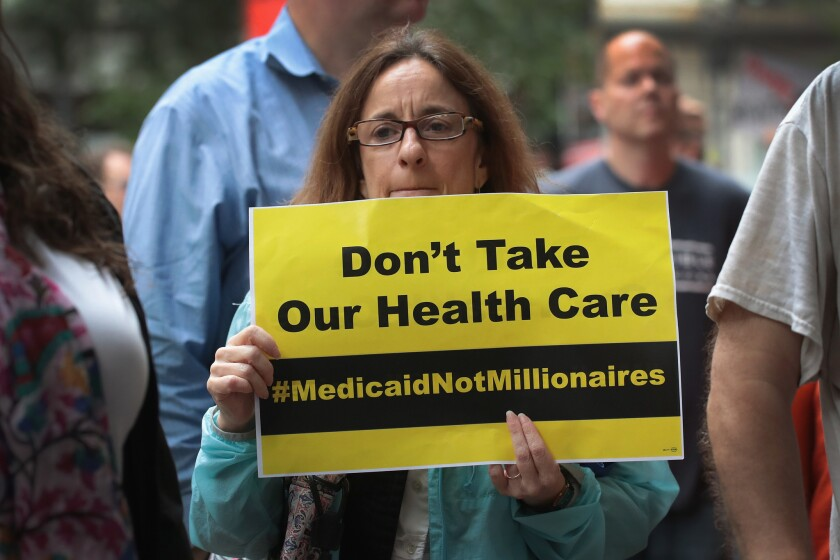CHICAGO, IL - JUNE 28: Demonstrators protest changes to the Affordable Care Act on June 28, 2017 in Chicago, Illinois. After more senators said they would not offer support, senate Republican's yesterday announced they would delay a vote on their revised health-care bill. (Photo by Scott Olson/Getty Images) ** OUTS - ELSENT, FPG, CM - OUTS * NM, PH, VA if sourced by CT, LA or MoD **