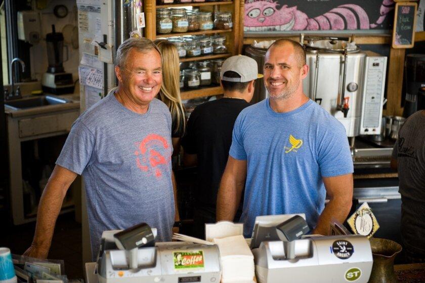 Shawn Holder, left, and son Dempsey run the iconic Pannikin Coffee & Tea in Encinitas. CREDIT: Tom Pfingsten