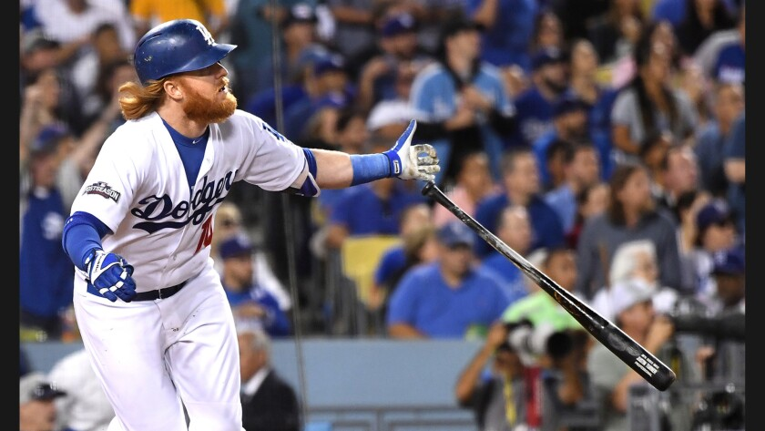 Dodgers third baseman Justin Turner hits a solo home run against Cubs pitcher Jake Arrieta in the sixth inning in Game 3 of the NLCS.