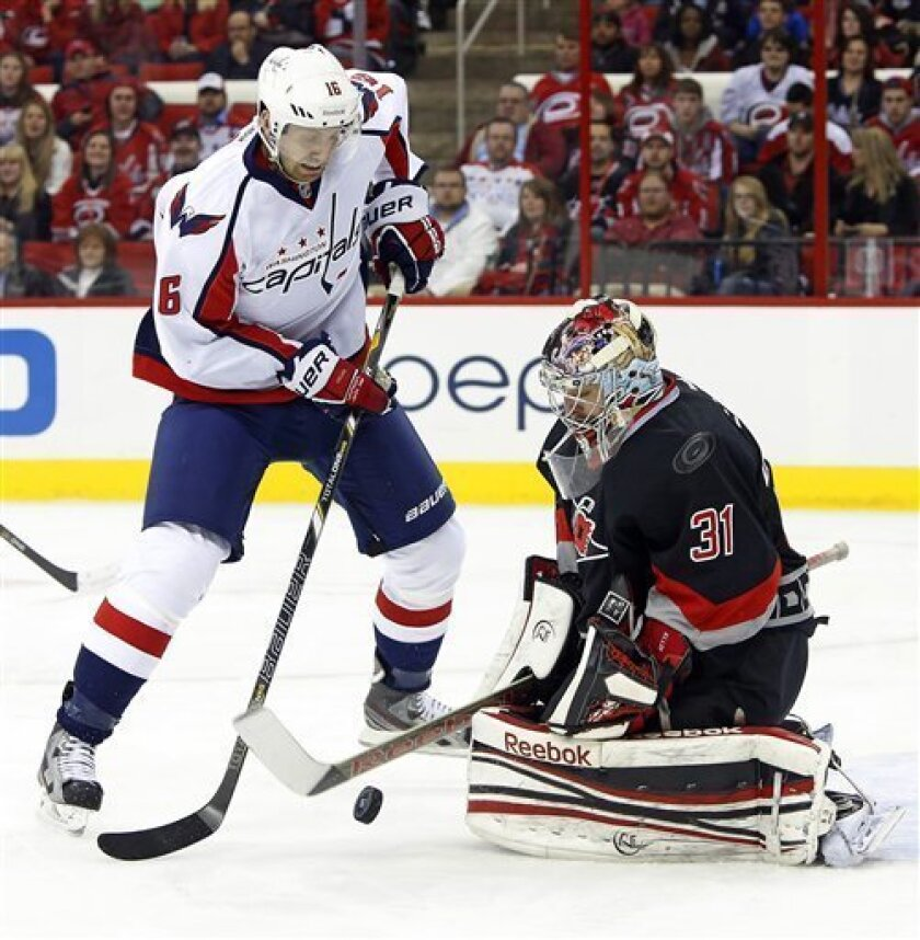 Carolina Hurricanes goalie Dan Ellis (31) blocks the shot of Washington Capitals' Eric Fehr (16) during the first period of an NHL hockey game on Thursday, March 14, 2013, in Raleigh, N.C. (AP Photo/Karl B DeBlaker)