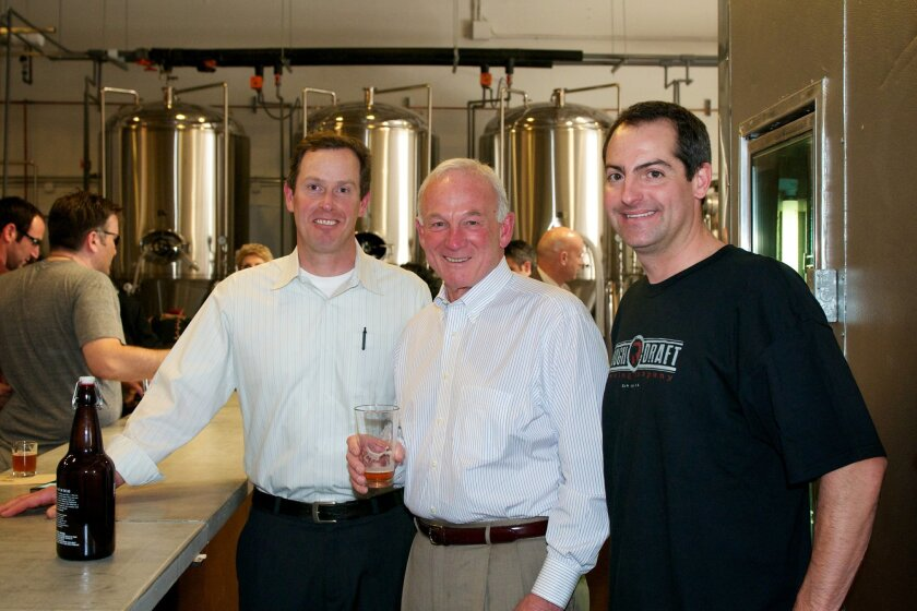 (from left) Jon Stahley, Mayor Jerry Sanders and Jeff Silver during a soft opening of Rough Draft Brewing Company March 9.