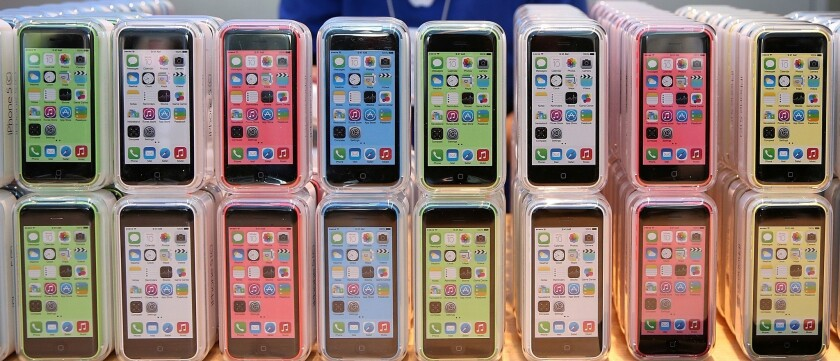 Rows of the iPhone 5c are displayed at an Apple store in 2013.