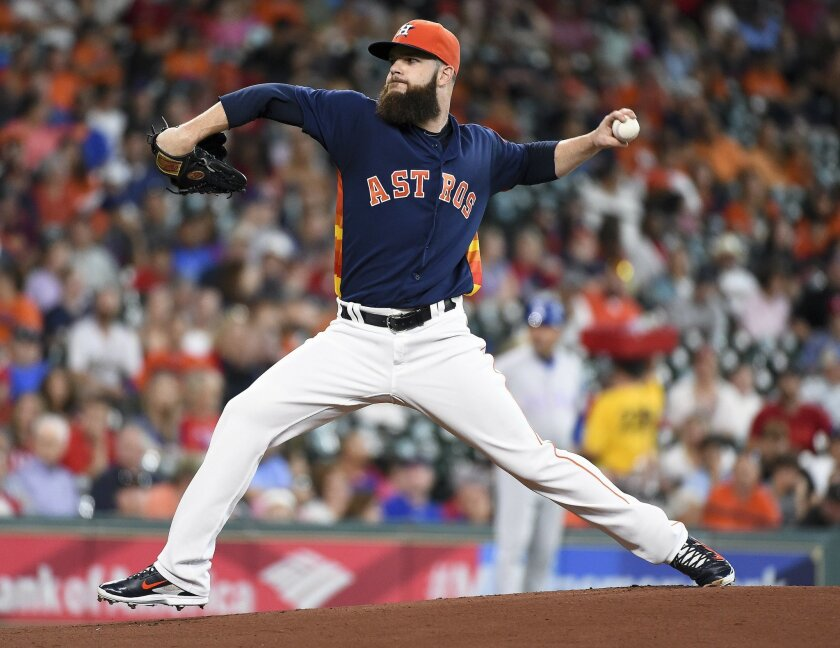 Houston Astros starting pitcher Dallas Keuchel delivers during the first inning of a baseball game against the Texas Rangers, Sunday, May 22, 2016, in Houston. (AP Photo/Eric Christian Smith)