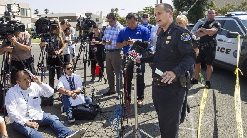 Huntington Beach Police Chief Robert Handy takes questions during a news conference in 2017.