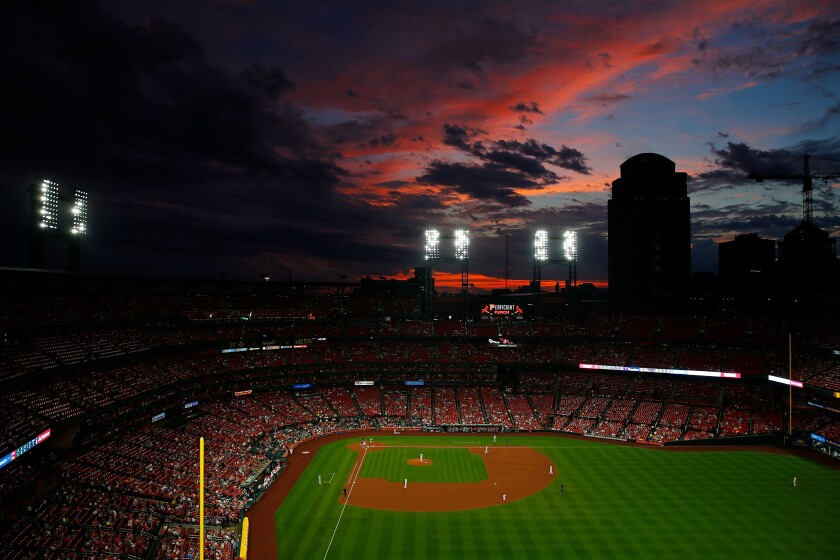 The sun sets over Busch Stadium during a game between the St. Louis Cardinals and the Cincinnati Reds on June 4, 2019.