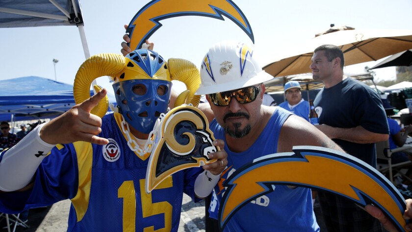 Playing in different conferences, the Rams and Chargers might not see too much of each other in the regular season. So fans Paul Castaneda, left, and Bryan Bahr used last month's exhibition to show their true colors.