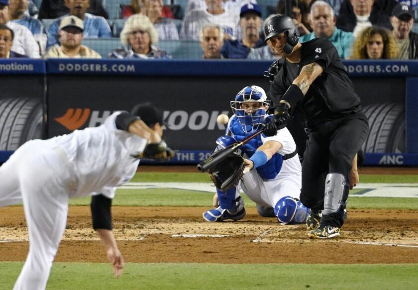 Yankees catcher Gary Sanchez hits a solo home run off Dodgers starter Hyun-Jin Ryu on Friday.