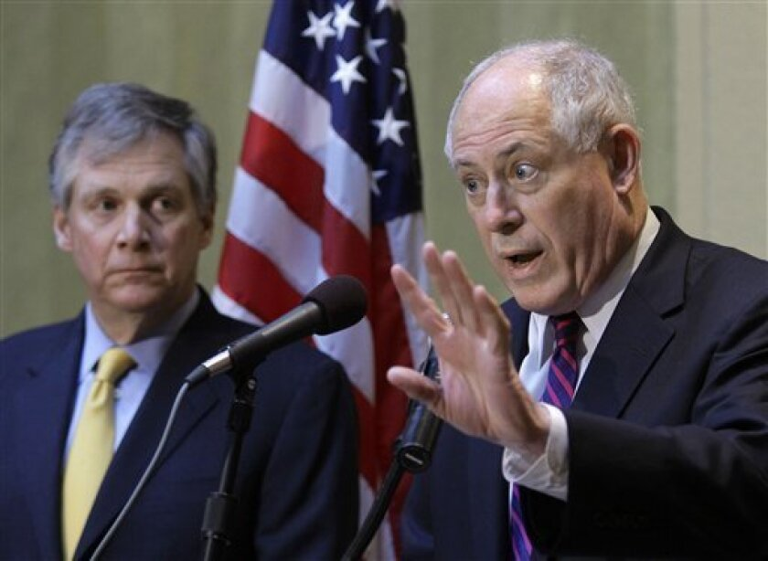 Illinois Gov. Pat Quinn, right, and Caterpillar CEO Doug Oberhelman, left, discuss Illinois' business climate and taxes during a news conference, Tuesday, April 5, 2011, in Peoria, Ill. (AP Photo/Seth Perlman)