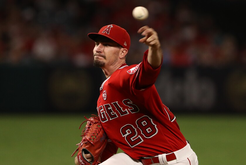 Angels pitcher Andrew Heaney delivers during the first inning of an 11-4 loss to the Tampa Bay Rays on Friday.
