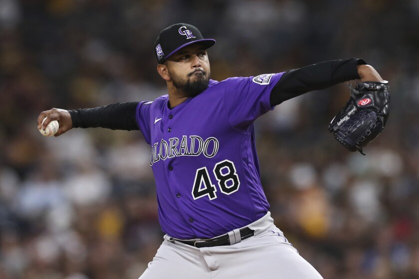 Colorado Rockies starting pitcher German Marquez winds up during the third inning of the team's baseball game against the San Diego Padres, Saturday, July 10, 2021, in San Diego. (AP Photo/Derrick Tuskan)
