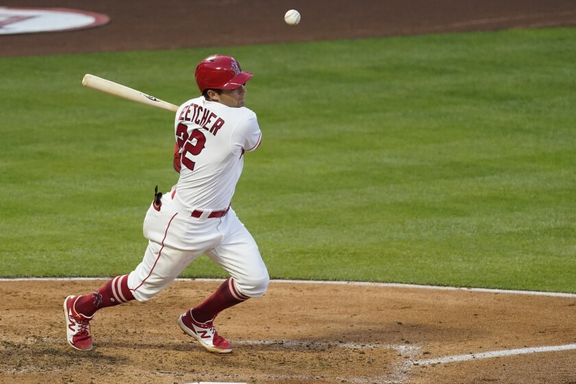 Los Angeles Angels' David Fletcher (22) singles during the third inning of a baseball game against the Chicago White Sox Saturday, April 3, 2021, in Anaheim, Calif. (AP Photo/Ashley Landis)